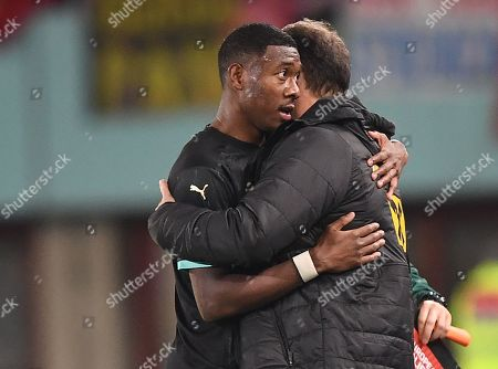 Stock Image of David Alaba (L) of Austria hugs his head coach Franco Foda after wining the UEFA EURO 2020 group G qualifying soccer match between Austria and North Macedonia in Vienna, Austria, 16 November 2019.