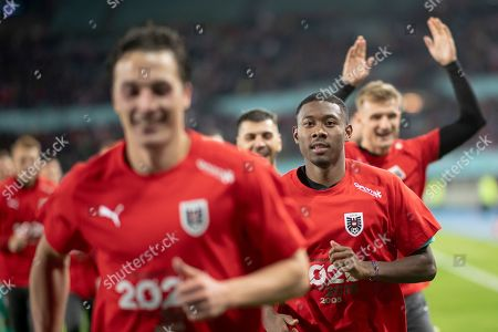 Julian Baumgartlinger (L) and David Alaba (R) of Austria celebrate after winning the UEFA EURO 2020 group G qualifying soccer match between Austria and North Macedonia in Vienna, Austria, 16 November 2019