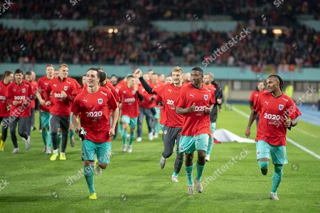 (L-R) Julian Baumgartlinger, David Alaba and Valentino Lazaro of Austria celebrate after winning the UEFA EURO 2020 group G qualifying soccer match between Austria and North Macedonia in Vienna, Austria, 16 November 2019