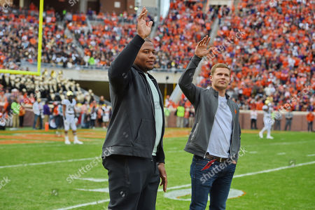Dexter Lawrence, Adam Humphries. Former Clemson standouts and now current NFL players (l-r) Dexter Lawrence-New York Giants and Adam Humphries-Tennessee Titans, greet the fans during the first half of an NCAA college football game against Wake Forest, in Clemson, S.C