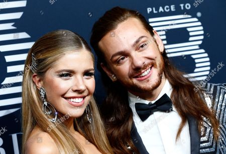 Moderators Victoria Swarovski (L) and Riccardo Simonetti pose on the black carpet for the 'Place to B' awards, in Berlin, Germany, 16 November 2019. The event awards the most important and influential German social media personalities.