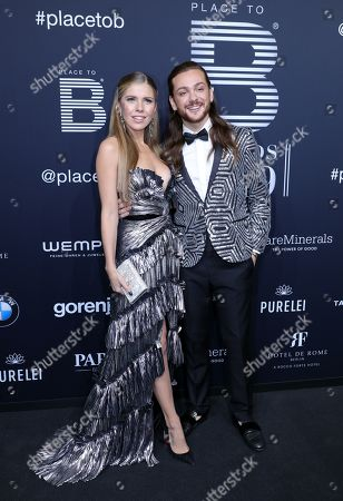 Stock Photo of Moderators Victoria Swarovski (L) and Riccardo Simonetti pose on the black carpet for the 'Place to B' awards, in Berlin, Germany, 16 November 2019. The event awards the most important and influential German social media personalities.