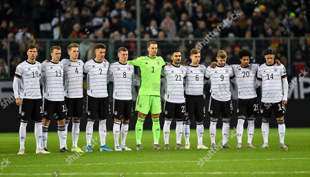 Stock Picture of Germany's team stand together for a minute of silence prior the Euro 2020 group C qualifying soccer match between Germany and Belarus in Moenchengladbach, Germany,. Players and fans remembered former national goalkeeper Robert Enke, who committed suicide 10 years ago