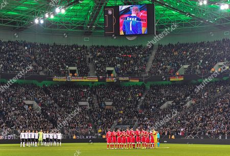 Germany's and Belarus' team stand together for a minute of silence prior the Euro 2020 group C qualifying soccer match between Germany and Belarus in Moenchengladbach, Germany,. Players and fans remembered former national goalkeeper Robert Enke, who committed suicide 10 years ago