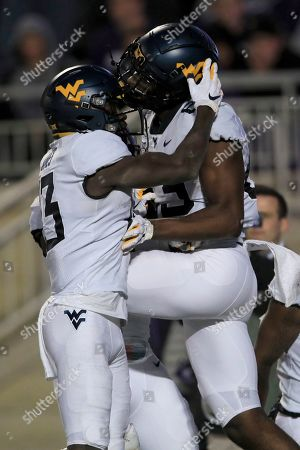 Stock Photo of Sam James, Bryce Wheaton. West Virginia wide receiver Sam James (13) congratulates fellow wide receiver Bryce Wheaton (83) after a touchdown during the second half of an NCAA college football game against Kansas State in Manhattan, Kan