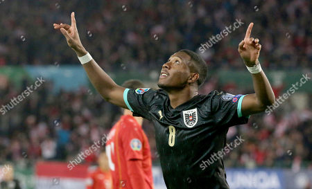 Stock Photo of Austria's David Alaba reacts after scoring during the Euro 2020 group G qualifying soccer match between Austria and North Macedonia at Ernst-Happel stadium in Vienna, Austria