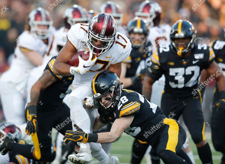 Minnesota wide receiver Seth Green (17), left, runs the ball as he is tackled by Iowa defensive back Jack Koerner during the first half of an NCAA college football game, in Iowa City, Iowa