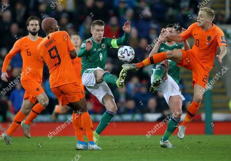 Stock Image of Northern Ireland vs The Netherlands. Northern Ireland's Steven Davis and Netherlands' Donny van de Beer