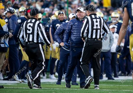 Notre Dame head coach Brian Kelly disagrees with the call during NCAA football game action between the Navy Midshipmen and the Notre Dame Fighting Irish at Notre Dame Stadium in South Bend, Indiana. Notre Dame defeated Navy 52-20