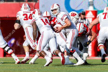 Lincoln, NE. U.S. - Wisconsin Badgers quarterback Jack Coan #17 turns to hand off to Wisconsin Badgers running back Nakia Watson #14 in action during a NCAA Division 1 football game between Wisconsin Badgers and the Nebraska Cornhuskers at Memorial Stadium in Lincoln, NE. .Attendance: 88,842.Wisconsin won 37-21