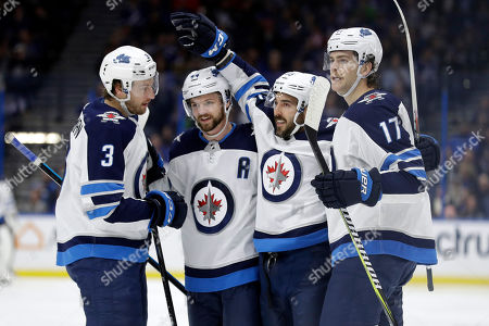 Tucker Poolman, Josh Morrissey, Mathieu Perreault, Adam Lowry. Winnipeg Jets center Mathieu Perreault, second from right, celebrates his goal against the Tampa Bay Lightning with defenseman Tucker Poolman, left, defenseman Josh Morrissey, second from left, and left wing Adam Lowry, right. during the first period of an NHL hockey game, in Tampa, Fla