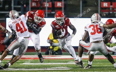 Rutgers Scarlet Knights running back Aaron Young (4) finds some room to run during an NCAA football game between the Ohio State Buckeyes and the Rutgers Scarlet Knights at SHI Stadium in Piscataway, NJ