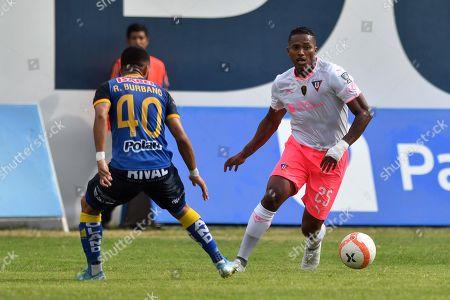 Liga de Quito's Antonio Valencia in action before Delfin's Robert Burbano (L) during their Copa Ecuador final game, at the Jocay stadium, in Manta, Ecuador, 16 November 2019.