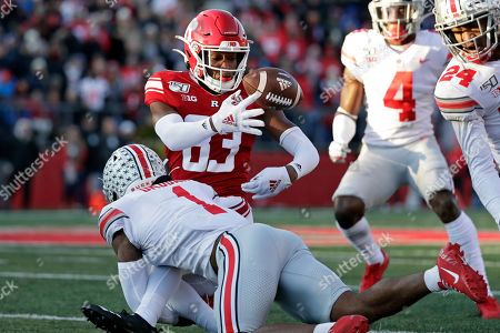 Rutgers wide receiver Isaiah Washington fumbles the ball as he is tackled by Ohio State cornerback Jeff Okudah (1) during the first half of an NCAA college football game, in Piscataway, N.J