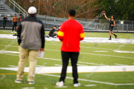 Free agent quarterback Colin Kaepernick participates in a workout for NFL football scouts and media, in Riverdale, Ga