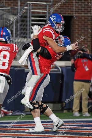 Mississippi quarterback John Rhys Plumlee (10) and offensive lineman Michael Howard (52) celebrate after a touchdown during the second half of the team's NCAA college football game against LSU in Oxford, Miss., . LSU won 58-37