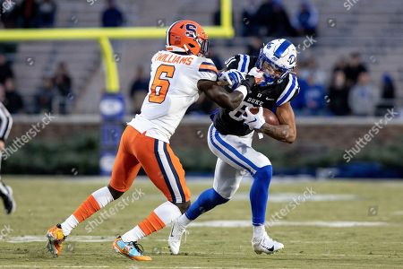 Duke's Aaron Young (81) carries the ball as Syracuse's Trill Williams (6) attempts a tackle during the first half of an NCAA college football game in Durham, N.C