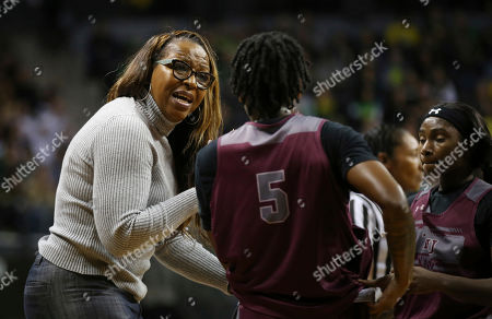 Stock Image of Texas Southern head basketball coach Cynthia Cooper-Dyke, left, talks to her players Ciani Cryor, center, and Jekalen Jones during the second quarter of an NCAA college basketball game against Oregon, in Eugene, Ore