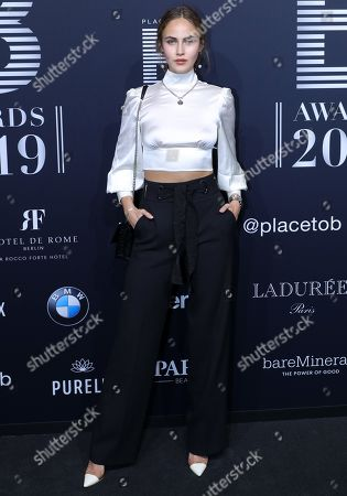 Model Elena Carriere poses on the black carpet for the 'Place to B' awards, in Berlin, Germany, 16 November 2019. The event awards the most important and influential German social media personalities.