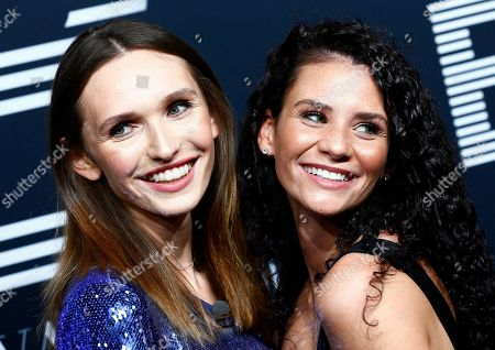 Model Anna Wilken (L) and Betty Taube pose on the black carpet for the 'Place to B' awards, in Berlin, Germany, 16 November 2019. The event awards the most important and influential German social media personalities.