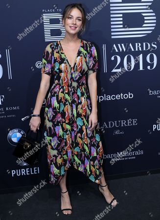 Actress Janina Uhse poses on the black carpet for the 'Place to B' awards, in Berlin, Germany, 16 November 2019. The event awards the most important and influential German social media personalities.