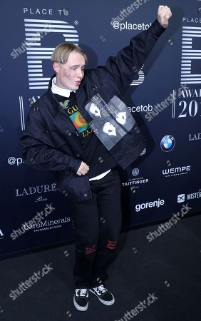 Stock Photo of Musician Isac Elliot poses on the black carpet for the 'Place to B' awards, in Berlin, Germany, 16 November 2019. The event awards the most important and influential German social media personalities.