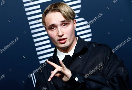 Musician Isac Elliot poses on the black carpet for the 'Place to B' awards, in Berlin, Germany, 16 November 2019. The event awards the most important and influential German social media personalities.