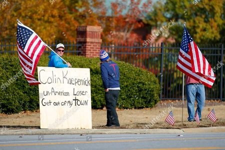 Stock Picture of Protesters show up for a planned Colin Kaepernick workout for NFL football scouts, in Flowery Branch, Ga