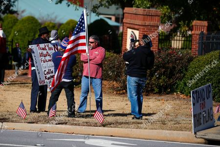 Stock Image of Protesters and supporters show up for a planned Colin Kaepernick workout for NFL football scouts, in Flowery Branch, Ga