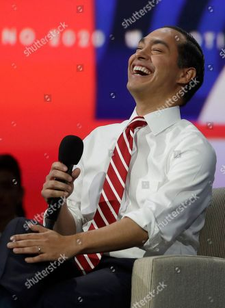 Democratic presidential candidate former U.S. Secretary of Housing and Urban Development Julian Castro laughs during a presidential forum at the California Democratic Party's convention, in Long Beach, Calif