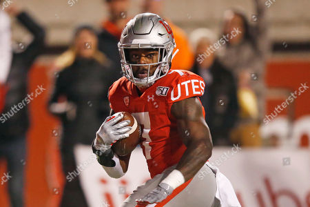 Utah running back Devonta'e Henry-Cole (7) carries the ball against UCLA in the second half during an NCAA college football game, in Salt Lake City