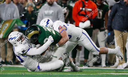 R m. Colorado State running back Jaylen Thomas, center, is stopped after a short gain by Air Force linebackers Kyle Johnson, left, and Grant Donaldson in the first half of an NCAA football game in Fort Collins, Colo
