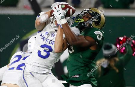 Stock Photo of R m. Colorado State wide receiver EJ Scott, right, pulls in a pass for along gain as Air Force defensive back Milton Bugg III defends in the second half of an NCAA football game in Fort Collins, Colo. Air Force won 38-21