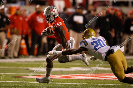 Devonta'e Henry-Cole, Elisha Guidry. Utah running back Devonta'e Henry-Cole (7) out runs UCLA defensive back Elisha Guidry (20) on his way to a touchdown in the second half during an NCAA college football game, in Salt Lake City