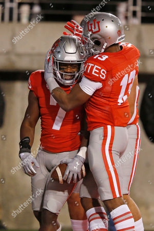 Devonta'e Henry-Cole, Donte Banton. Utah's Devonta'e Henry-Cole (7) celebrates with Donte Banton (13) after scoring against UCLA during the second half of an NCAA college football game, in Salt Lake City