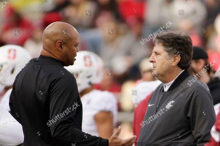 Stanford head coach David Shaw, left, and Washington State head coach Mike Leach speak before an NCAA college football game in Pullman, Wash