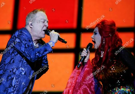 Kate Pierson, Fred Schneider. Fred Schneider, left, and Kate Pierson members of the American new wave rock band The B-52s, performs during the Corona Capital music festival in Mexico City