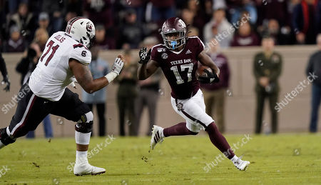 Texas A&M wide receiver Ainias Smith (17) returns a punt as South Carolina offensive lineman Eric Douglas (71) defends during the second quarter of an NCAA college football game, in College Station, Texas