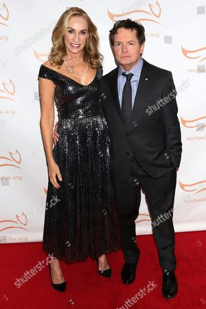 """Tracy Pollan, Michael J Fox. Tracy Pollan, left, and Michael J Fox attend the Michael J Fox Foundation's """"A Funny Thing Happened on the Way to Cure Parkinson's"""" Gala to benefit Parkinson's research at the Hilton New York, in New York"""