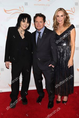 """Joan Jett, Michael J Fox, Tracy Pollan. Joan Jett, from left, Michael J Fox and Tracy Pollan attend the Michael J Fox Foundation's """"A Funny Thing Happened on the Way to Cure Parkinson's"""" Gala to benefit Parkinson's research at the Hilton New York, in New York"""