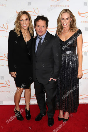 """Sheryl Crow, Michael J Fox, Tracy Pollan. Sheryl Crow, from left, Michael J Fox and Tracy Pollan attend the Michael J Fox Foundation's """"A Funny Thing Happened on the Way to Cure Parkinson's"""" Gala to benefit Parkinson's research at the Hilton New York, in New York"""