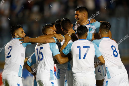 Stock Picture of Guatemala's Carlos Gallardo is congratulated by teammates after scoring his side's opening goal against Puerto Rico during a CONCACAF Nations League soccer match at the Doroteo Guamuch Flores stadium in Guatemala City