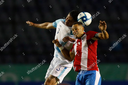 Puerto Rico's Sidney Rivera, right, and Guatemala's Carlos Gallardo vie for the ball during a CONCACAF Nations League soccer match at the Doroteo Guamuch Flores stadium in Guatemala City