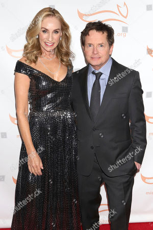"""Tracy Pollan, Michael J Fox. Tracy Pollan and Michael J Fox attend the Michael J Fox Foundation's """"A Funny Thing Happened on the Way to Cure Parkinson's"""" Gala to benefit Parkinson's research at the Hilton New York, in New York"""