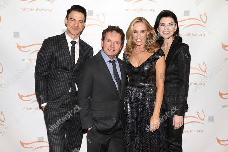 """Keith Lieberthal, Michael J Fox, Tracy Pollan, Julianna Margulies. Keith Lieberthal, from left, Michael J Fox, Tracy Pollan and Julianna Margulies attend the Michael J Fox Foundation's """"A Funny Thing Happened on the Way to Cure Parkinson's"""" Gala to benefit Parkinson's research at the Hilton New York, in New York"""