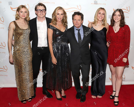 "Stock Photo of Schuyler Frances Fox, Sam Michael C Fox, Tracy Pollan, Michael J Fox, Aquinnah Kathleen Fox, Esme Annabelle Fox. Schuyler Frances Fox, from left, Sam Michael C Fox, Tracy Pollan, Michael J Fox, Aquinnah Kathleen Fox and Esme Annabelle Fox attend the Michael J Fox Foundation's ""A Funny Thing Happened on the Way to Cure Parkinson's"" Gala to benefit Parkinson's research at the Hilton New York, in New York"