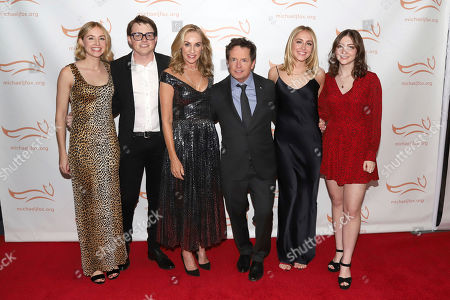 "Stock Image of Schuyler Frances Fox, Sam Michael C Fox, Tracy Pollan, Michael J Fox, Aquinnah Kathleen Fox, Esme Annabelle Fox. Schuyler Frances Fox, from left, Sam Michael C Fox, Tracy Pollan, Michael J Fox, Aquinnah Kathleen Fox and Esme Annabelle Fox attend the Michael J Fox Foundation's ""A Funny Thing Happened on the Way to Cure Parkinson's"" Gala to benefit Parkinson's research at the Hilton New York, in New York"