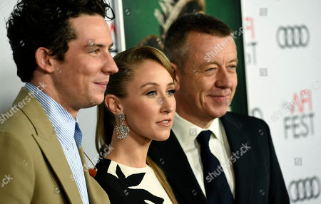 """Peter Morgan, Josh O'Connor, Erin Doherty. Peter Morgan, right, the creator/writer/executive producer of """"The Crown,"""" poses with cast members Josh O'Connor, left, and Erin Doherty at a gala screening of the show at the 2019 AFI Fest at the TCL Chinese Theatre, in Los Angeles"""