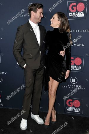 Armie Hammer, Elizabeth Chambers. Armie Hammer, left, and Elizabeth Chambers attend the 13th Annual Go Gala at NeueHouse Hollywood, in Los Angeles