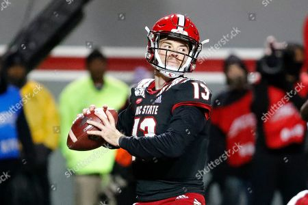 North Carolina State quarterback Devin Leary (13) looks to throw the ball against Louisville during the second half of an NCAA college football game in Raleigh, N.C